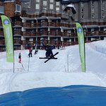 Ski jump with inflatable landing. My son looks like a pro but had never skied before this week..