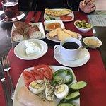 breakfast assortment (arabic platter in front, omlette opposite)