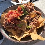Delicious pulled pork nachos on the rooftop patio