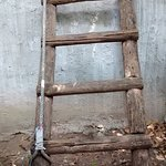 Ladder down to bathroom area. Turns to mud after a shower, wash feet off at top of ladder.