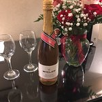 Chilled pink sparkling wine & lovely roses awaited our arrival