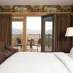 A luxury lodge room with balcony at Mountain Top Resort
