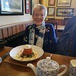 Mum enjoying her fishcakes