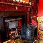 The cosy real fire in the pub interior