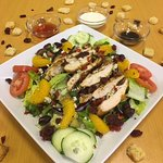 Crusted Parmigiano & Oregano Chicken Breast. Over a toss salad w/ Orange, Cranberries & Almonds