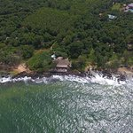 Aerial shot of Mango Bay Resort seafront; On The Rocks Restaurant in the center