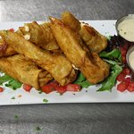 Our most popular app is our Buffalo Chicken Roll. It is and stuffed in a spiced wrapper and frie