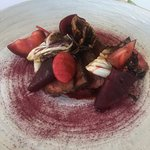 Venison cooked over charcoal, blood plums, beetroot, radicchio and mirto