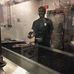 Part of the friendly staff serving up great food.