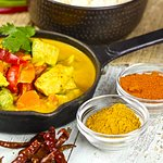 Yellow Curry with potatoes, bell pepper and carrot.