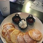 Ricotta Pancakes with Chantilly Cream, Nutella, and Homemade Strawberry Coulis