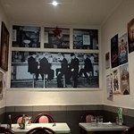 Interior of Gaby's Deli showing photos decorating the walls.