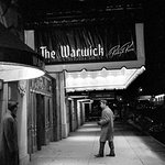 Elvis entering The Warwick in 1956.
