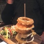 Double burger with home made onion rings, black pudding and cheese