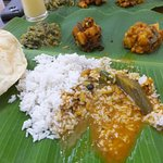 Banana Leaf Rice with the vegetable condiments and Inidan Crackers