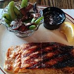 Catch of the Day - Salmon served with vegetables.