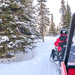 Snow Mobiling in Sky High Wilderness Ranch