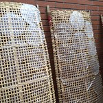 Rice paper circles on drying racks - each circle is a wrapper for spring roll