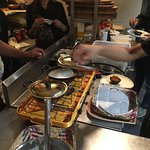 """Making the """"hoppers"""", bowl crepes"""