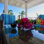 All Accommodations have a large, screened in patio over the stunning beach and turquoise water