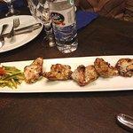 Skewered chicken, served in an interesting manner