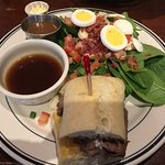 Beef sandwich au jus and spinach salad