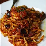 Linguini Putenesca, prawns, capers, black olives and a spicy tomato sauce