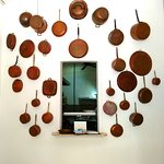 West wall showing modern decor: copper pots and pans