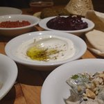 some of the small dishes along with fresh pita