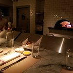 Pizza oven/counter area in the back.  Quaint and quiet (while the rest of the restaurant was pac