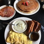 Pancakes and Ham steak - Omelet with grits and wheat toast