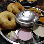 Kombadi vade (Fried Indian breads with chicken curry)