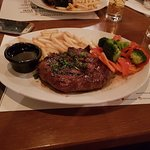 Rib eye steak with Jack Daniel's sauce and french fries with steamed vegetables