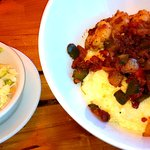 Shrimp & grits with bacon bits and cole slaw.