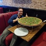My son in law and his Hughgilio monster pizza