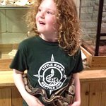 Yes that's a live snake around the Junior Herper's waist!! She is a volunteer helper at the zoo,