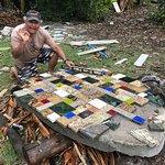 Shai making a tile tabletop.
