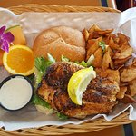 Blackened grouper sandwich with chips