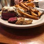 Rare sirloin steak mushrooms, onions, cheese and fries.