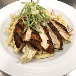 Pasta N'Awlins: blackened chicken breast, sauteed onions, leaks, bacon, w/ penne pasta