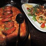 Two tapas - chorizo with beans and calamari