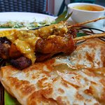 Roti canai with curry sauce, chicken sate