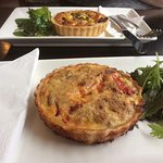 Bacon and egg quiche at back, tuna and capsicum quiche