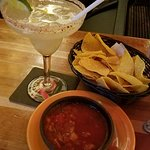 House margarita on the rocks and house-made salsa