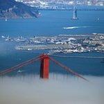 Golden Gate Tower peeking above the fog.