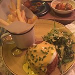 Smoked salmon fishcake with poached egg, hollandaise, wild rocket and fries