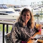 OUt eating on the deck admiring the yachts.