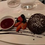 chocolate molten lava cake with raspberry sauce