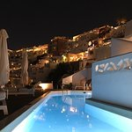 Pool view at night looking up to town