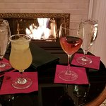Drinks by fireplace.